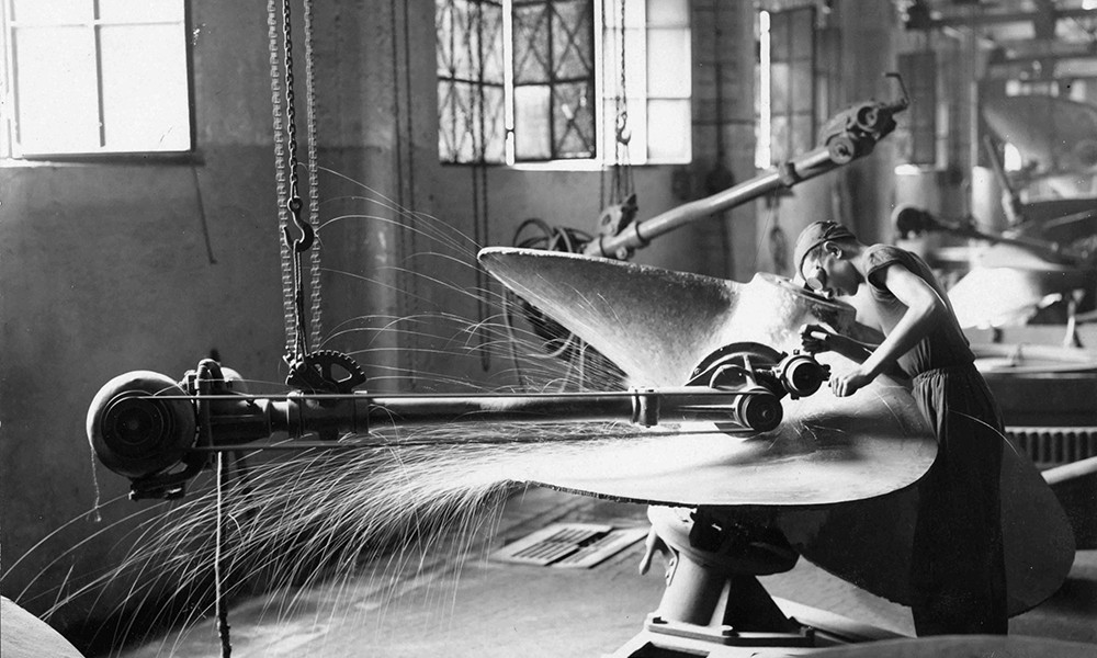 Metalworkers working on a ships propeller in the Ansaldo factory.