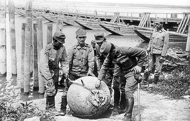 Austro-Hungarian soldiers with a sea mine